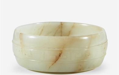A Chinese pale celadon and russet jade circular coupe...