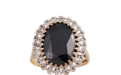 A DIAMOND AND SAPPHIRE CLUSTER RING, the oval sapphire to di...