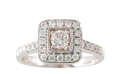 A DIAMOND CLUSTER RING, of square form, the round brilliant ...