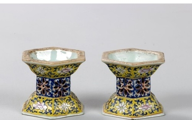 A PAIR OF CHINESE FAMILLE ROSE YELLOW GROUND FOOTED BOWLS, Q...