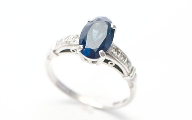 A SAPPHIRE AND DIAMOND RING IN 18CT WHITE GOLD, THE OVAL CUT BLUE SAPPHIRE WEIGHING 2.98CTS AND DIAMONDS TOTALLING 0.10CTS, SIZE P,...