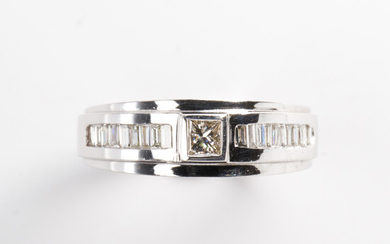 A diamond and fourteen karat white gold ring