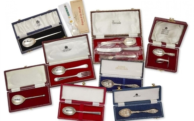 A group of cased silver christening sets of flatware including: an Asprey & Co. silver fork and spoon set, London, c.1972; a hammered silver spoon by Mappin & Webb; two decorative 'birth year' silver spoons; a silver knife, fork and spoon set...
