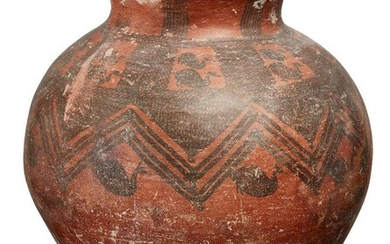 A large Anatolian pottery vessel, circa 2nd Millennium B.C., the rounded vessel tapering to the base and neck, with a flaring mouth, the red burnished ground decorated with black painted decoration composed of birds and cross-hatching around the...