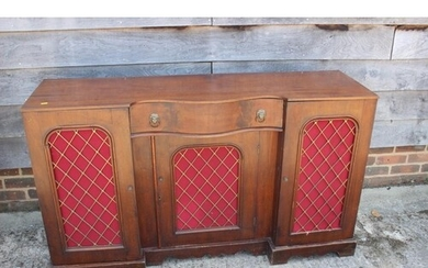 A late 19th century mahogany break serpentine front sideboar...