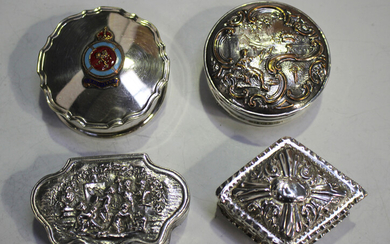 A late Victorian silver lozenge shaped box with hinged lid, decorated in relief with scrolls within