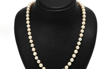 NOT SOLD. A pearl necklace set with numerous cultured pearls and a clasp set with a glass stone and diamonds, mounted in 18k gold and silver. L. app. 66 cm. – Bruun Rasmussen Auctioneers of Fine Art