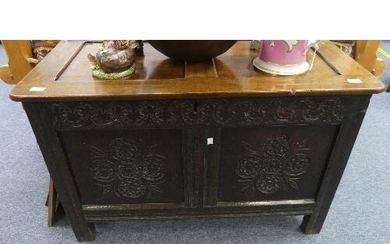 An antique oak Coffer, 17th century and later, the hinged tw...