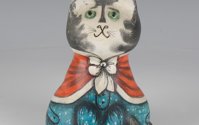 An early Joan and David De Bethel Rye papier-mâché cat, dated 1966, seated wearing a blue
