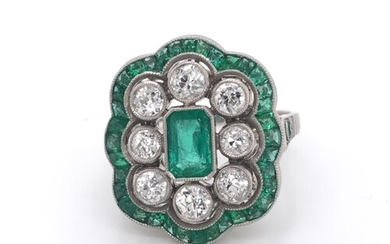 Diamond and emerald ring in platinum mount. Central emerald ...