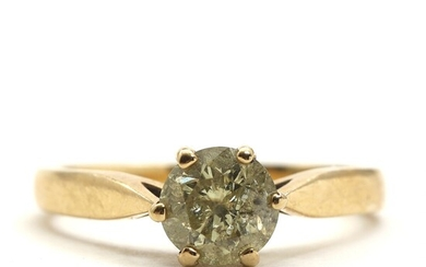 Diamond ring set with brilliant-cut yellowish diamond weighing app. 0.87 ct., mounted in 14k gold....