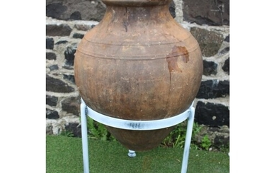 Early 1900's olive pot mounted on a black wrought iron stand...