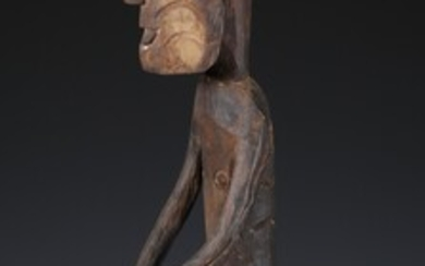 Papua, Asmat, standing male figure, the prominent penis covered by his hands