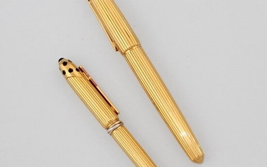 TWO GOLD PENS, CARTIER