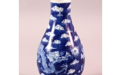 A CHINESE BLUE & WHITE PORCELAIN DRAGON VASE, with clouds an...