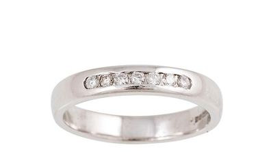 A DIAMOND SET BAND RING, channel set with brilliant cut diam...