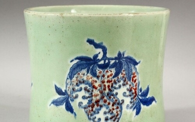 A LARGE CHINESE CELADON GLAZED BRUSH POT, the decorated with...