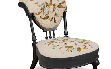 A LATE VICTORIAN EBONISED FRAME UPHOLSTERED ROLL-BACK LOW...