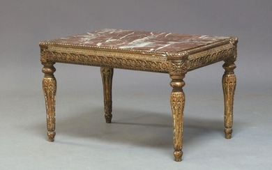 A Louis XVI or later gilt side table, the rectangular red and and white variegated marble top, above guilloche and foliate carved frieze on fluted legs to toupie feet, possibly originally a stool, 43cm high, 68cm wide, 48cm deep