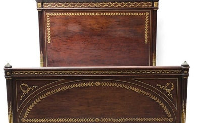 A Louis XVI-style plum pudding mahogany double bed