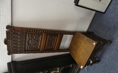 A Victorian carved oak Hall Chair, the high back carved with...