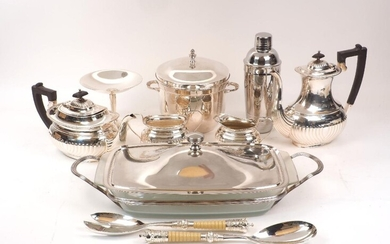 A group of silver plate including: a small novelty flute; an ice bucket, a cocktail shaker, a four piece tea set; a serving dish with glass liner, a tazza, four square trinket boxes with lids and personalised engraving; two small novelty watering...
