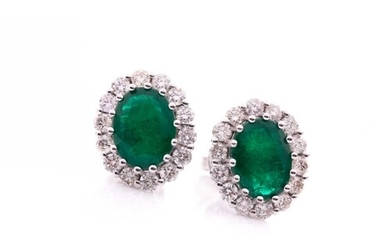 A pair of diamond and emerald cluster earrings, each set wit...