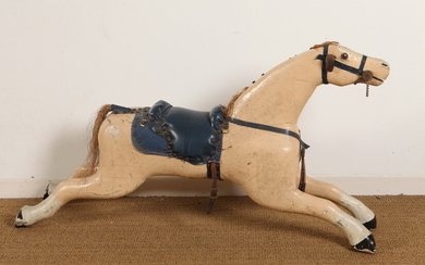 CARVED AND PAINTED FOLK FIGURE OF GALLOPING HORSE WITH BLUE...
