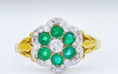 EMERALD AND DIAMOND CLUSTER RING, set with a central diamond...