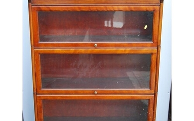 Mahogany stacking bookcase, the three sections each with gla...