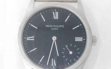 Patek Philippe. Limited Edition and Sophisticated Calatrava Wristwatch in Platinum, Reference 5026, With Black Dial Made for the New Millennium and Extract from Archives