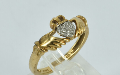 A 10CT GOLD AND DIAMOND CLADDAGH RING