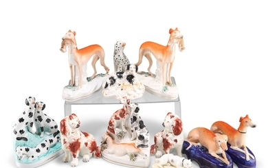 A COLLECTION OF STAFFORDSHIRE POTTERY DOG MODELS, 19TH CENTU...