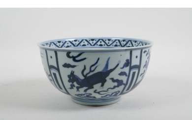 A Chinese blue and white porcelain bowl decorated with flowe...