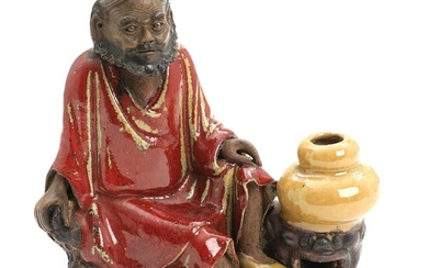 A Chinese partly glazed ceramic figure of a Lohan. Late Qing. 19th century. H. 17.5 cm. – Bruun Rasmussen Auctioneers of Fine Art
