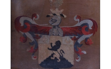 A George III needlework armorial panel, worked in coloured t...