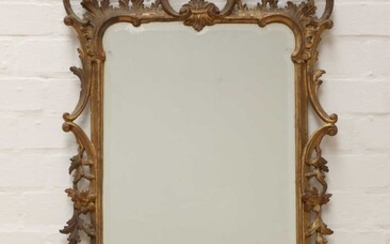A George III-style carved giltwood wall mirror