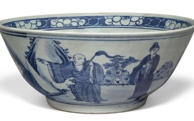 A large Chinese porcelain blue and white bowl, 19th century, decorated with scholars and attendants in a continuous landscape, apocryphal underglaze blue Qianlong four-character mark to base, 29cm diameter