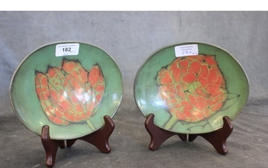 A pair of modern pottery leaf pattern dishes, green ground e...