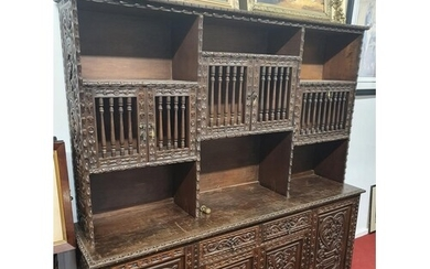 A superb 20th Century highly carved Oriental style Cabinet w...