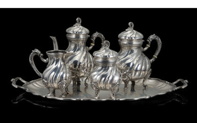 """A titled 800 silver tea and coffee set, comprising of: coffee pot, teapot, sugar bowl, milk jug. Silversmith """"C.A.F"""" (h.…Read more"""
