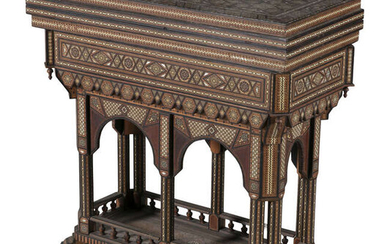 AN MIDDLE EASTERN INLAID OLIVEWOOD GAMES TABLE, profusely...