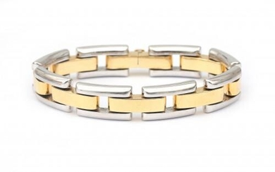 An 18 karat gold two tone link bracelet. Composed of puffy alternating links in white and yellow gold, to a tongue clasp. Gross weight: 39.36 g.
