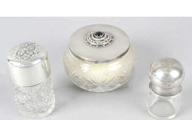 Two silver topped glass perfume bottles, a silver mounted ring tree (a.f), a bud vase (filled base), and a silver lidded glass powder bowl. (5).