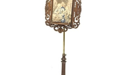 Victorian rosewood and brass music stand, floral fretwork frame...