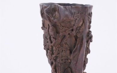 A Chinese carved wood brush pot