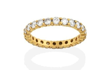 A Diamond Eternity Ring, by Cartier, the round brilliant cut...