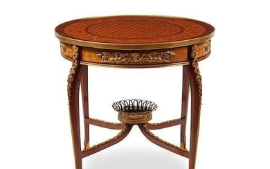 A LOUIS XVI STYLE GILT BRONZE MOUNTED PARQUETRY TABLE