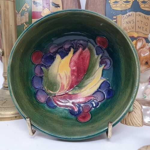 A Moorcroft Pottery Leaf and Berry pattern bowl, paper label...