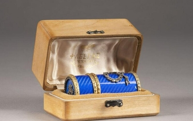 A SILVER-GILT AND GUILLOCHÉ ENAMEL BOX WITHIN FITTED